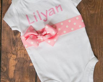 Personalized Name Outfit with light pink name and pink polk a dot sash!