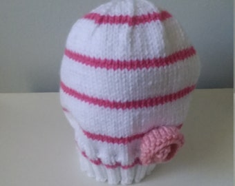 White and pink hat with pink flower