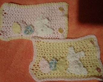 2pk. Crochet Light pink/ light yellow bottle covers. With sown on colorful eggs and white rabbit.
