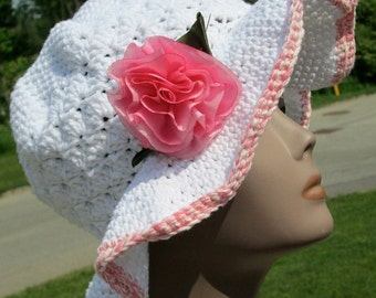 Women's crochet hat, summer hat, beach hat, sun hat, vacation hat, brimmed hat, chemo hat, in white with pink trim. Silk rose pin accent