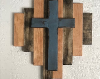 Wood cross on wood background