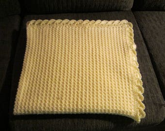 Hand crocheted baby blanket with baby yarn.