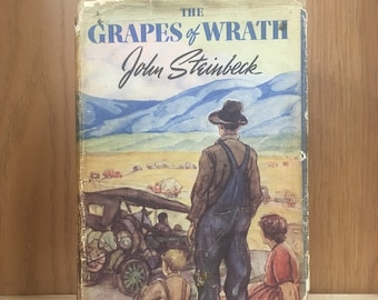 The Grapes of Wrath by John Steinbeck. Early printing in original dust jacket, 10 months after first edition. Great classic gift for reader!