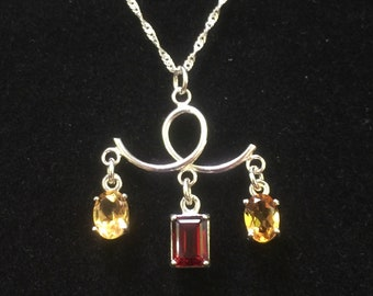 Unique sterling loop pendant with garnet and citrine gemstones.