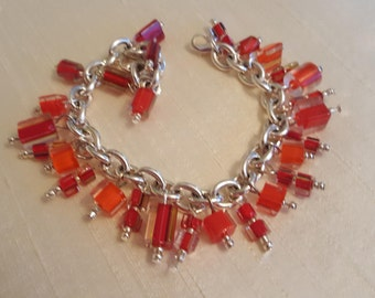 Shades of Red Furnace Glass/Cane Glass Bracelet. Handmade Beautiful Glass Dangles Ready for Spring!