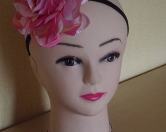 with its pink elastic headband
