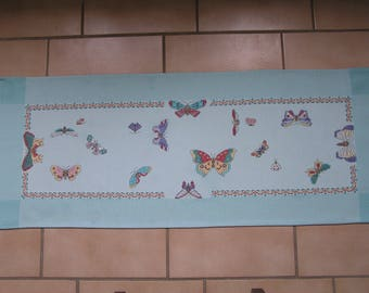 Blue table runner with embroidered butterflies