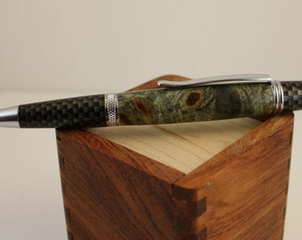 Handmade Ballpoint Twist Pen, dyed buckeye burl and carbon fiber coating.