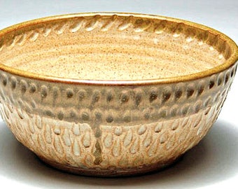 Wattlefield Pottery Bowl, with hand carved raindrop texture.  Wheel - thrown by Andrea Young.  Stoneware, beige.