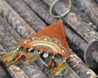 Rustic orange hand embroidered key chain with floral embroidery. Textile key chain. Woolen keychain with tassels.