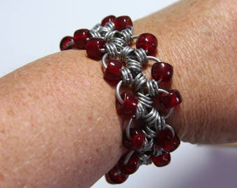 "Chainmaille/Chain mail Japanese 12-in-1 style bracelet. Anodised Aluminium/Aluminum with red beads. 7 1/4"" Length."