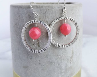 Coral earrings. Hammered Silver hoops orbiting hot coral pink faceted drops. Perfect for weddings or every day.