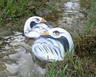 Swan painted on a river stone