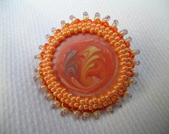 Orange Sherbert: a unique upcycled hand beaded mixed media brooch created from a vintage odd enamelled earring, seed beads, hand-dyed cotton