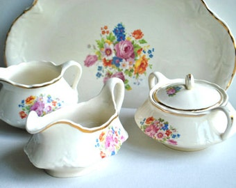 Vintage 30s porcelain set of four: tray, sugar bowl, creamer, greavy dish with delicate pastel color  flowers  patern.