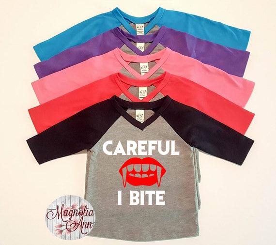 Careful I Bite, Vampire, Halloween,  Infant Baby V-Neck Baseball Raglan T-shirt in 5 Colors in Sizes 6 Months-24 Months