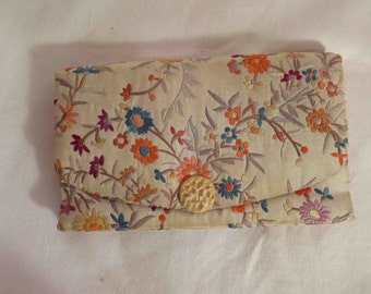 Vintage Chinese embroidered silk clutch with carved accent button