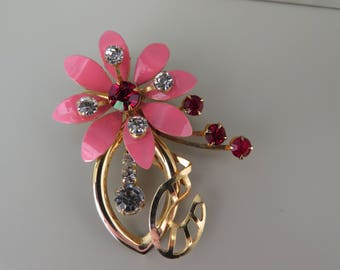 Very pretty vintage pink flower articulated brooch.