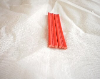 2 red bows fimo canes