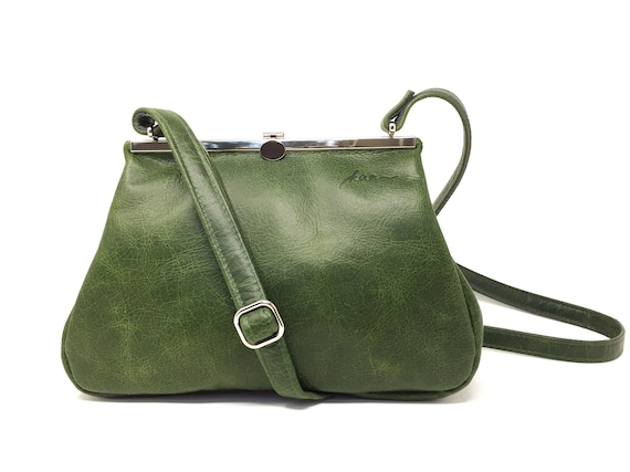 green leather bag with metal closure