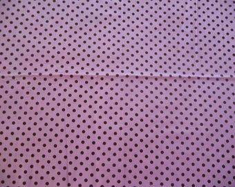 Fabric is pink with Brown dots