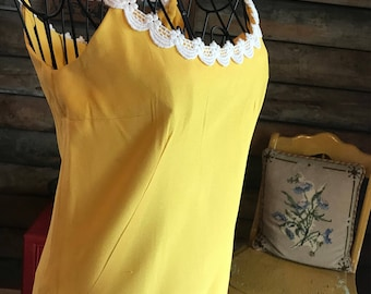 1970s Yellow summer dress with brocade details on edges of dress and straps