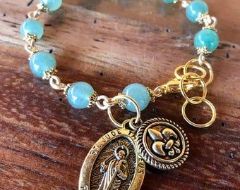 Handmade St. Jude prayer bracelet in green aventurine gemstone beads, gold toned die cast St. Jude and fleur de lis charms