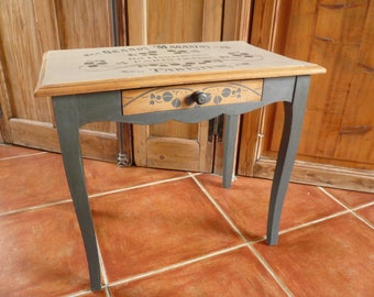 Side 1 drawer coffee table natural wood black and taupe inscription stencil