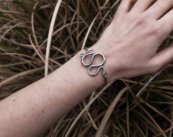 Small Snake Cuff, Handmade in Austin Texas by Jamie Spinello, available in Bronze or Sterling Silver