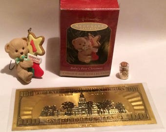 Hallmark Keepsake Babys first Christmas and 24k Gold plated pvc bill and Jar of Gold Flakes.