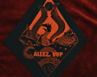 Red print Allez Oop sea monster on black canvas