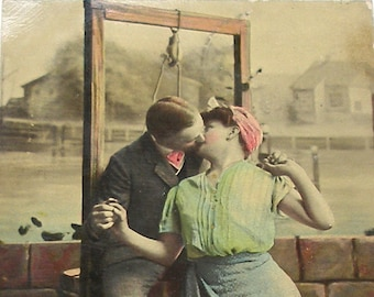 1900s French postcard, Kissing by the well, Antique RPPC real photo, paper ephemera.