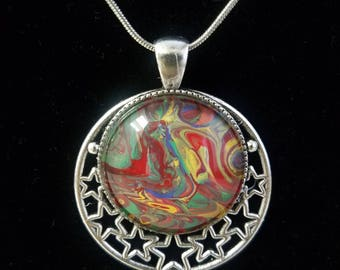 002- Beautiful Acrylic Pour Pendant with stars on a 20in. chain