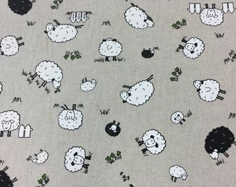 Sheep print cotton fabric in beige by the Half