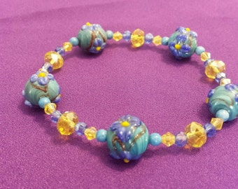 Bracelet:  Beautiful Flowered Lampworks Beaded Stretch Bracelet with Turquoise Blue and Yellow Swarovski Crystals