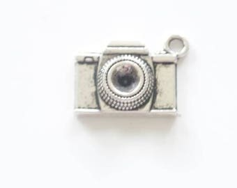 In antique silver camera charm