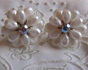 Vintage Gold Tone White Plastic Flowered Screw Back Earrings with Iridescent Rhinestone Centers