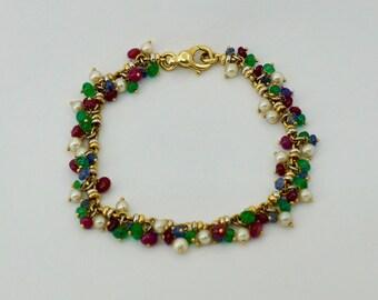 Vintage 18ct.gold pearl and gemstone bracelet