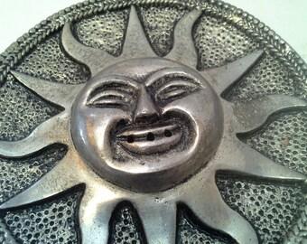 Silver tone sun