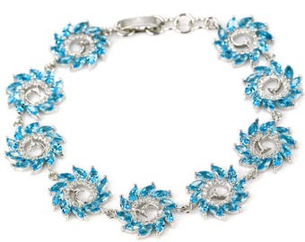 Sterling Silver Swiss Blue Topaz Gemstone Bracelet With AAA CZ Acccents