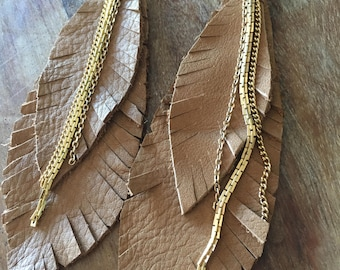 Tan leather feather shoulder duster earrings with gold chains