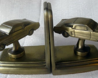 1964 - 65 - 66 vintage Ford Mustang auto car brass bookends a pair all metal USA