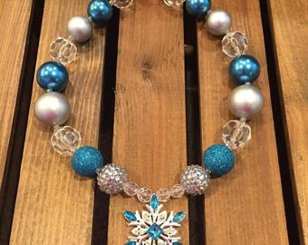 Frozen inspired chunky bead necklace, has turquoise, clear and silver with large silver and turquoise snowflake pendant.