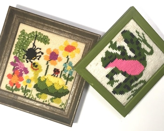 Pair of vintage framed needlepoint creatures