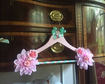 Pink and blue vintage wood clothes hanger art