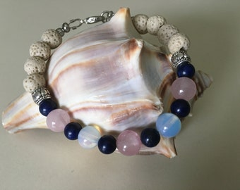 Be in the Knowing with this Lapis Lazuli, Opalite And Rose Quartz Adjustable Bracelet!