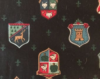 Yardage: Horse pictures of shields on black . 2 yds( still on the bolt)  -CLEARANCE.