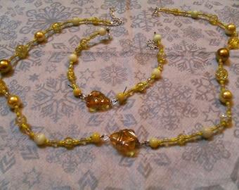 set (necklace and bracelet) fine, classy, dressy (yellow)