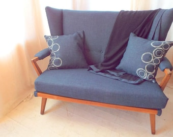 GPlan 1953 Wing settee, model no. B401, fully reupholstered