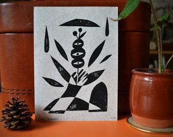 Linocut on handmade recycled paper